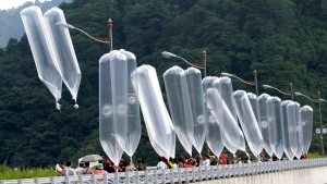 FILE - In this July 29, 2010, file photo, South Korean conservative activists launch balloons carrying leaflets denouncing North Korean leader Kim Jong Il during a rally in Hwacheon, South Korea. South Korea says it plans to push new laws to ban activists from flying anti-Pyongyang leaflets over the border after North Korea threatened to end an inter-Korean military agreement reached in 2018 to reduce tensions if Seoul fails to prevent the protests. (AP Photo/Ahn Young-joon, File)