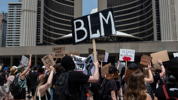 Protesters gather at city hall in Toronto to honour black lives lost at the hands of police, on Friday, June 5, 2020. THE CANADIAN PRESS/Chris Young