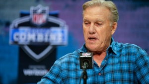 In this Feb. 25, 2020, file photo, Denver Broncos president of football operations and general manager John Elway speaks during a press conference at the NFL football scouting combine in Indianapolis. Elway has selected a defensive player with his first draft pick six times in his nine drafts. (AP Photo/Michael Conroy, File)