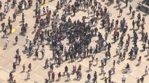 Protesters are seen gathering in Nathan Phillips Square for an anti-Black racism protest on Saturday afternoon.