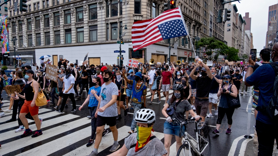 Activists move along W. 34th Street, Saturday, June 6, 2020, in New York. Protests continued following the death of George Floyd who died after being restrained by Minneapolis police officers on May 25. (AP Photo/Craig Ruttle)