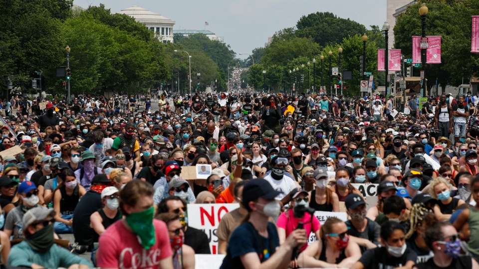 Demonstrators protest Saturday, June 6, 2020, in Washington, over the death of George Floyd, a black man who was in police custody in Minneapolis. Floyd died after being restrained by Minneapolis police officers. (AP Photo/Alex Brandon)
