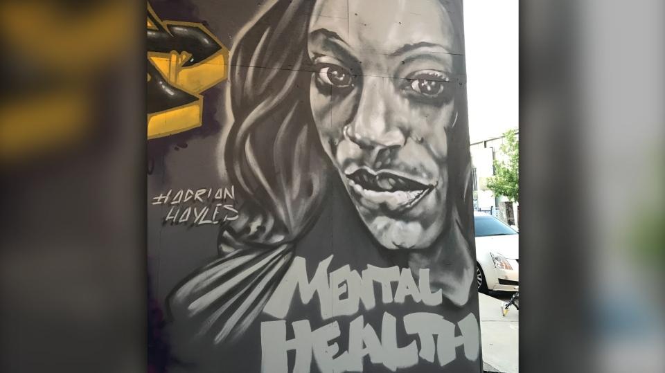 A mural of Regis Korchinski-Paquet is painted at Toronto's graffiti alley. (Beatrice Vaisman)