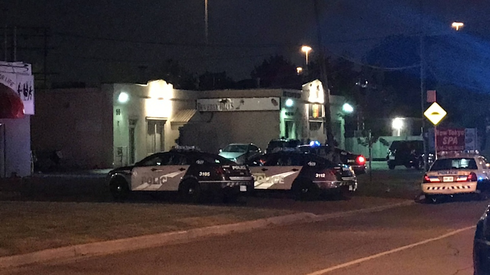 Police are shown at the scene of a shooting on Beverly Hills Drive late Tuesday night. (Mike Nguyen)