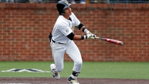 FILE - In this May 11, 2019, file photo, Vanderbilt's Austin Martin connects for a hit during an NCAA college baseball game against Missouri in Nashville, Tenn. (AP Photo/Wade Payne, FIle)
