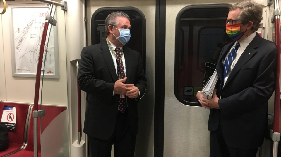 Mayor John Tory and TTC CEO Rick Leary are shown riding the subway on Thursday while wearing a face mask. (Twitter/@JohnTory)