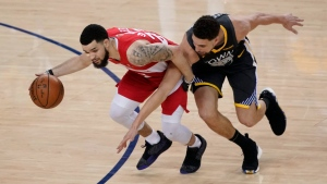 Toronto Raptors guard Fred VanVleet, left, dribbles against Golden State Warriors guard Klay Thompson during the first half of Game 6 of basketball's NBA Finals in Oakland, Calif., Thursday, June 13, 2019. THE CANADIAN PRESS/AP-Tony Avelar