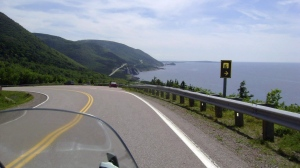 This July 13, 2010 photo shows the road along the Cabot Trail in Cape Breton, Nova Scotia. If you're looking to explore Canada this summer, you'll first have to navigate the fluctuating patchwork of travel restrictions aimed at preventing the spread of the novel coronavirus throughout the country. THE CANADIAN PRESS/AP-Glenn Adams
