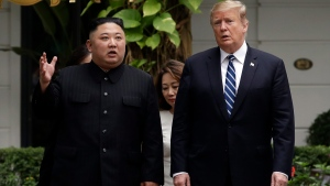 In this Feb. 28, 2019, file photo, U.S. President Donald Trump, right, and North Korean leader Kim Jong Un take a walk after their first meeting at the Sofitel Legend Metropole Hanoi hotel in Hanoi, Vietnam. (AP Photo/Evan Vucci, File)