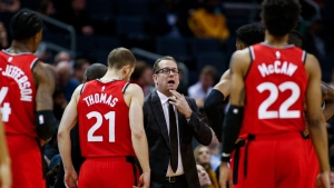 In this Jan. 8, 2020, file photo, Toronto Raptors coach Nick Nurse, center, gathers his team during a timeout in the first half of an NBA basketball game against the Charlotte Hornets in Charlotte, N.C. (AP Photo/Nell Redmond, File)