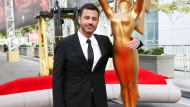 This Sept. 14, 2016 file photo shows host Jimmy Kimmel posing for a photo with a replica of an Emmy statue at the Primetime Emmy Awards Press Preview Day in Los Angeles. (Photo by Rich Fury/Invision/AP, File)