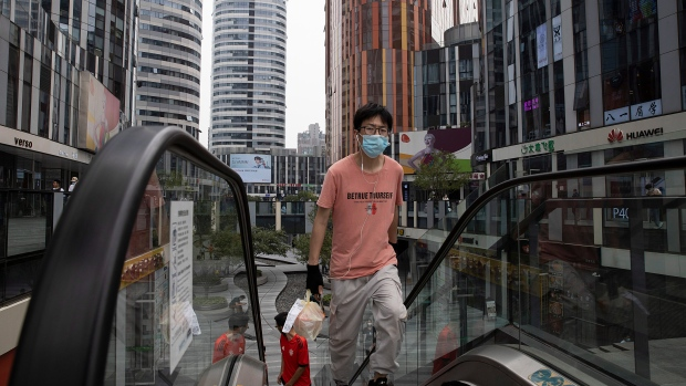 New virus cases in China, N. Zealand sound pandemic alarm