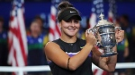 Bianca Andreescu, of Canada, holds up the championship trophy after defeating Serena Williams, of the United States, in the women's singles final of the U.S. Open tennis championships Saturday, Sept. 7, 2019, in New York. THE CANADIAN PRESS/AP, Charles Krupa