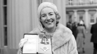 FILE - In this Dec. 2, 1975 file photo, singer Vera Lynn poses outside Buckingham Palace after being invested a Dame Commander of the British Empire. The family of World War II forces sweetheart Vera Lynn says she has died. She was 103 it was reported on Thursday, June 18, 2020. (PA via AP, File)