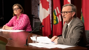 Dr. Barbara Yaffe listens as Ontario Chief Medical Officer of Health Dr. David Williams speaks at Queen's Park in Toronto on Wednesday March 25, 2020. THE CANADIAN PRESS/Frank Gunn