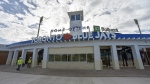 Workers walk past the main entrance to the TD Ballpark, the Florida home of Toronto Blue Jays, as they get the stadium ready in Dunedin, Fla., Sunday, Feb. 16, 2020. THE CANADIAN PRESS/Steve Nesius