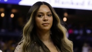 "FILE - In this Wednesday, June 5, 2019, file photo, Beyonce walks to her seat during the first half of Game 3 of basketball's NBA Finals between the Golden State Warriors and the Toronto Raptors in Oakland, Calif. Beyoncé did not let Juneteenth 2020 pass without dropping one of her signature surprises in the form a new single called ""Black Parade."" The singer's website says the song released late Friday, June 19, 2020, will benefit black-owned small businesses. (AP Photo/Ben Margot, File)"
