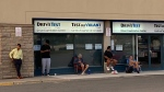 People lineup outside a DriveTest centre in Toronto on June 22, 2020. (Ken Enlow/ CP24)