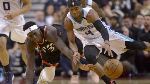 Toronto Raptors forward Pascal Siakam (43) and Charlotte Hornets guard Devonte' Graham (4) vie for control of the ball during second half NBA basketball action in Toronto, Friday, Feb. 28, 2020. The Raptors are headed south to prepare for the resumption of the NBA season.THE CANADIAN PRESS/Nathan Denette