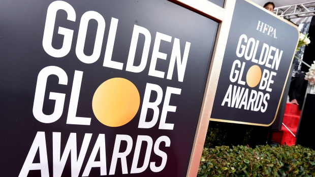 In this Jan. 6, 2019 file photo, Golden Globes signage appears on the red carpet at the 76th annual Golden Globe Awards in Beverly Hills, Calif. (Photo by Jordan Strauss/Invision/AP, File)