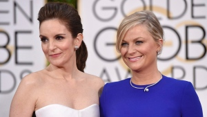 In this Jan. 11, 2015 file photo, Tina Fey, left, and Amy Poehler arrive at the 72nd annual Golden Globe Awards at the Beverly Hilton Hotel in Beverly Hills, Calif. (Photo by John Shearer/Invision/AP, File)