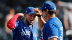 Toronto Blue Jays' Norberto Obeso, left, elbow bumps bench coach Dave Hudgens after the team's 7-5 win over the Pittsburgh Pirates in a spring training baseball game, Thursday, March 12, 2020, in Bradenton, Fla. THE CANADIAN PRESS/AP-Carlos Osorio