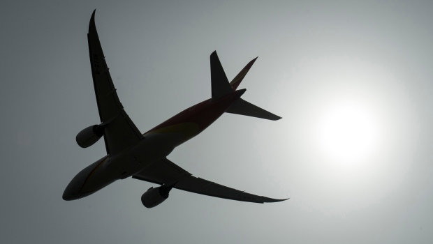 A plane is silhouetted as it takes off from Vancouver International Airport in Richmond, B.C., Monday, May 13, 2019. (THE CANADIAN PRESS / Jonathan Hayward)