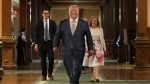 Ontario Premier Doug Ford is flanked by Monte McNaughton, Minister of Labour, Training and Skills Development, and Christine Elliott, Deputy Premier and Minister of Health, as he walks through the halls of Queen's Park, in Toronto, Wednesday, June 24, 2020. THE CANADIAN PRESS/POOL-Richard Lautens