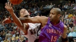 Toronto Raptors guard Vince Carter, front, reaches out to stop Denver Nuggets forward Tariq Abdul-Wahad of France from shooting in the first quarter in Denver, Sunday, Nov. 11, 2001. (AP Photo/David Zalubowski)