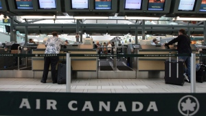 Air Canada passengers check in at the Vancouver International Airport on June 17, 2008. Air Canada has quietly changed its refund policy to allow some customers whose flights were cancelled due to the COVID-19 pandemic to recoup their cash. THE CANADIAN PRESS/Darryl Dyck