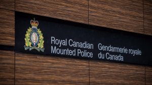 """The RCMP logo is seen outside Royal Canadian Mounted Police """"E"""" Division Headquarters, in Surrey, B.C., on April 13, 2018.THE CANADIAN PRESS/Darryl Dyck"""