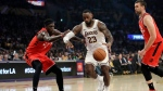 Los Angeles Lakers' LeBron James (23) dribbles between Toronto Raptors' Pascal Siakam, left, and Marc Gasol during the first half of an NBA basketball game Sunday, Nov. 10, 2019, in Los Angeles. (AP Photo/Marcio Jose Sanchez)