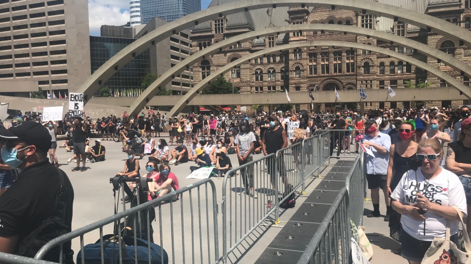 Thousands gathered at Nathan Phillips Square for the Abolish Police in Canada rally. (Janice Golding)