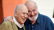 "In this April 7, 2017 file photo, Carl Reiner, left, and his son Rob Reiner pose together following their hand and footprint ceremony at the TCL Chinese Theatre in Los Angeles. Carl Reiner, the ingenious and versatile writer, actor and director who broke through as a ""second banana"" to Sid Caesar and rose to comedy's front ranks as creator of ""The Dick Van Dyke Show"" and straight man to Mel Brooks' ""2000 Year Old Man,"" has died, according to reports. Variety reported he died of natural causes on Monday night, June 29, 2020, at his home in Beverly Hills, Calif. He was 98. (Photo by Chris Pizzello/Invision/AP, File)"