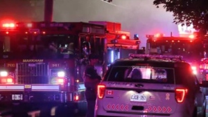 Fire trucks are shown at the scene of a house fire in Markham on Thursday morning.
