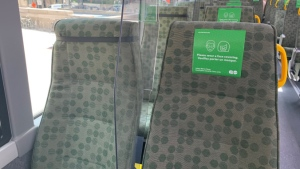 A plastic divider is shown between two seats on a GO bus. (Metrolinx)
