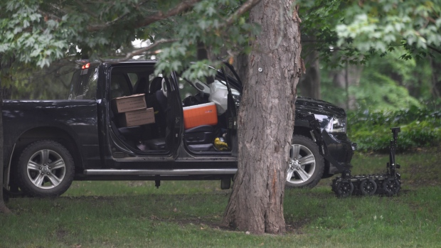 """A police robot is shown near a pickup truck inside the grounds of Rideau Hall in Ottawa on Thursday, July 2, 2020. The RCMP say they have safely resolved an """"incident"""" at Rideau Hall, where Gov. Gen. Julie Payette and Prime Minister Justin Trudeau live.THE CANADIAN PRESS/Adrian Wyld"""