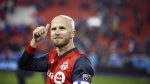 Toronto FC midfielder Michael Bradley (4) gives a thumbs up signal to the crowd following their victory against Atlanta United in MLS soccer action in Toronto, Sunday, Oct. 28, 2018. Buoyed by the return from injury of captain Bradley and Argentine newcomer Pablo Piatti, Toronto FC makes final preparations before it departs Friday for Florida and the MLS is Back Tournament. THE CANADIAN PRESS/Cole Burston