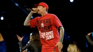 In this Feb. 15, 2014 file photo, singer Vanilla Ice performs during the skills competition at the NBA All Star basketball game, in New Orleans. (AP Photo/Gerald Herbert, File)