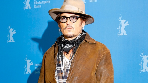 "This Feb. 21, 2020 file photo shows actor Johnny Depp during a photo-call for the film ""Minamata"" during the 70th International Film Festival Berlin, Berlinale in Berlin, Germany. (AP Photo/Markus Schreiber, File)"