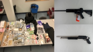Peel Regional Police say a man faces 17 charges after they seized guns, bullet-proof vests, 1,000 rounds of ammunition and drugs from a Brampton, Ont., home. (handout)