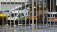 Ambulances are parked outside the COVID-19 field hospital created in the International Convention Centre in Cape Town, South Africa, Monday, June 29, 2020. South Africa's reported coronavirus are surging. Its hospitals are now bracing for an onslaught of patients, setting up temporary wards and hoping advances in treatment will help the country's health facilities from becoming overwhelmed. (AP Photo/Nardus Engelbrecht)