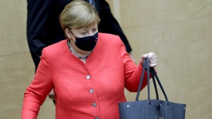 German Chancellor Angela Merkel wears a face mask as she arrives for a meeting of the upper house of the German legislative in Berlin, Germany, Friday, July 3, 2020. (AP Photo/Michael Sohn)