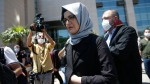 Hatice Cengiz, the fiancee of slain Saudi journalist Jamal Kashoggi, leaves a court in Istanbul, Friday, July 3, 2020, where the trial in absentia of two former aides of Saudi Crown Prince Mohammed bin Salman and 18 other Saudi nationals over the 2018 killing of the Washington Post columnist had began. Turkish prosecutors have indicted the 20 Saudi nationals over Khashoggi's grisly killing at the Saudi Consulate in Istanbul that cast a cloud of suspicion over Prince Mohammed and are seeking life prison terms for defendants who have all left Turkey. Saudi Arabia rejected Turkish demands for the suspects' extradition and put them on trial in Riyadh.(AP Photo/Emrah Gurel)