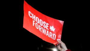 A support holds up a sign as Liberal leader Justin Trudeau holds a rally in Montreal, Quebec on Thursday Oct. 17, 2019. The Liberal Party eked out a small surplus in 2019, raising $42 million and spending $43 million. THE CANADIAN PRESS/Sean Kilpatrick