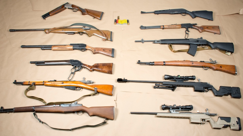 Police say they seized 12 long guns at a Brampton home on Friday after a hours-long standoff. (Handout)