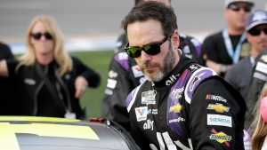 In this Feb. 16, 2020 file photo Jimmie Johnson climbs into his car before the NASCAR Daytona 500 auto race at Daytona International Speedway in Daytona Beach, Fla. (AP Photo/John Raoux, File)