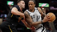 In this Sunday, March 8, 2020 file photo, San Antonio Spurs' DeMar DeRozan (10) drives past Cleveland Cavaliers' Larry Nance Jr. (22) in the second half of an NBA basketball game in Cleveland. The unusual resumption of the NBA season during the coronavirus pandemic is making mental health a priority. Mental health has been a major priority for the NBA and the NBPA, especially after players like Cleveland's Kevin Love and San Antonio's DeMar DeRozan opened up about their personal experiences and inner struggles.(AP Photo/Tony Dejak, File)