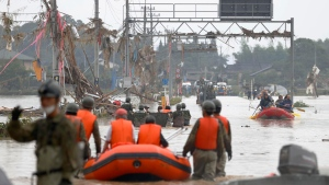 Rescue operation is underway following a heavy rain in Kumamura, Kumamoto prefecture, southern Japan Sunday, July 5, 2020. Deep floodwaters and the risk of more mudslides hampered search and rescue operations on Sunday in southern Japan, including at elderly home facilities where more than a dozen perished and scores are still stranded. (Kyodo News via AP)