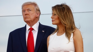 "President Donald Trump and first lady Melania Trump stand onstage during a ""Salute to America"" event on the South Lawn of the White House, Saturday, July 4, 2020, in Washington. (AP Photo/Patrick Semansky)"